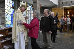 Comos greet Bishop