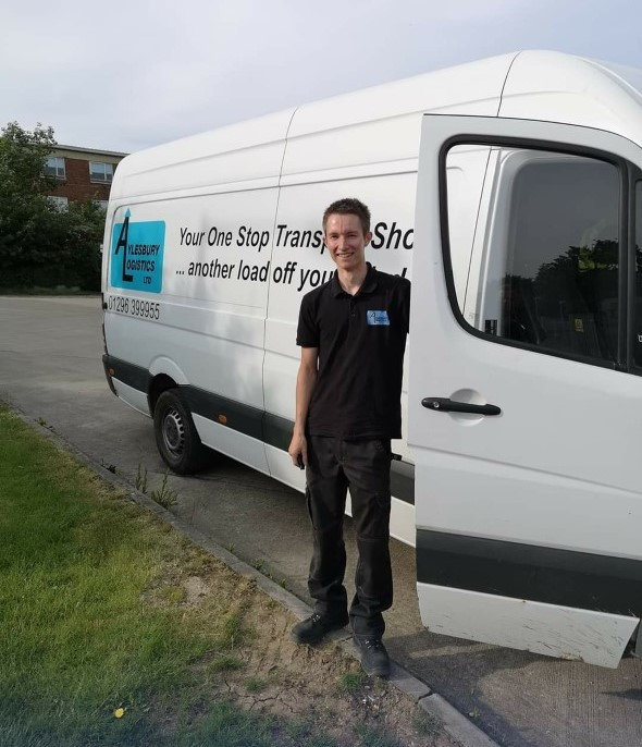 Aylesbury Logistics driver James Goss stands with his delivery vehicle