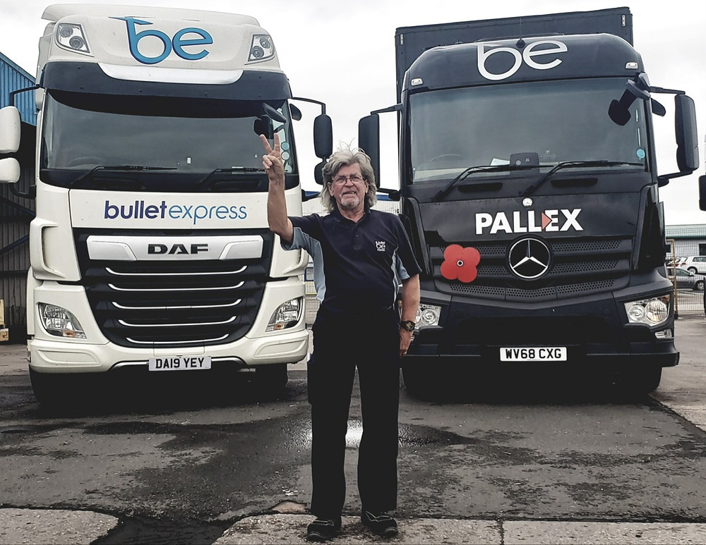 David Goodbrand standing in front of two Bullet Express trucks