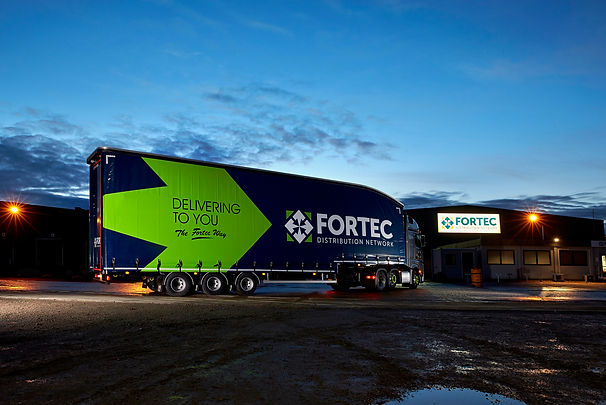 Fortec lorry in year at night