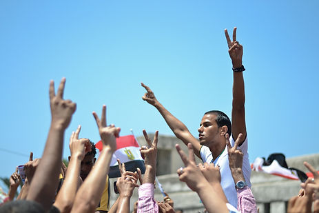 Peace-Caption-Protest-in-Alexandria-of-Egypt-calling-for-peace-and-social-justice_edited.j