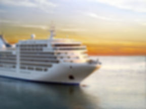 Luxury cruise ship sailing from port on