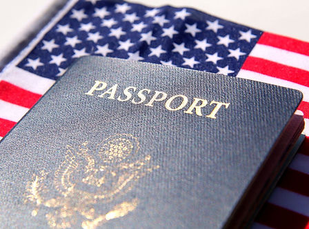 Stock Photo - US passport over a red, wh