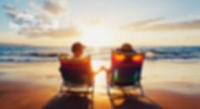 Couple enjoying beautiful sunset at the