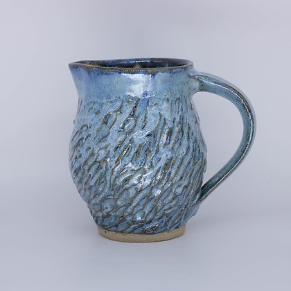 Blue-green textured jug