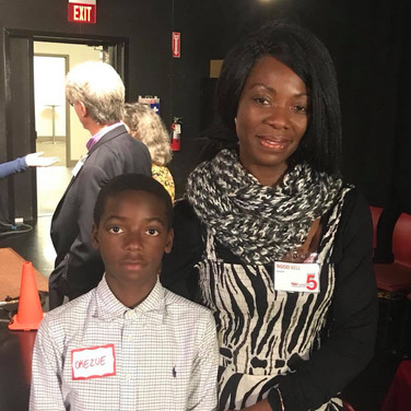 Ngozi Bell with her son at the Speakers' Reception