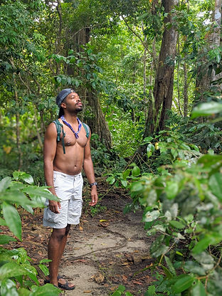 Ronnell Perry walking through a nature trail at Cahuita National Park.