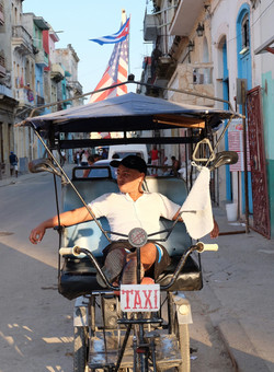 Pedi-taxi driver relaxes in Havana