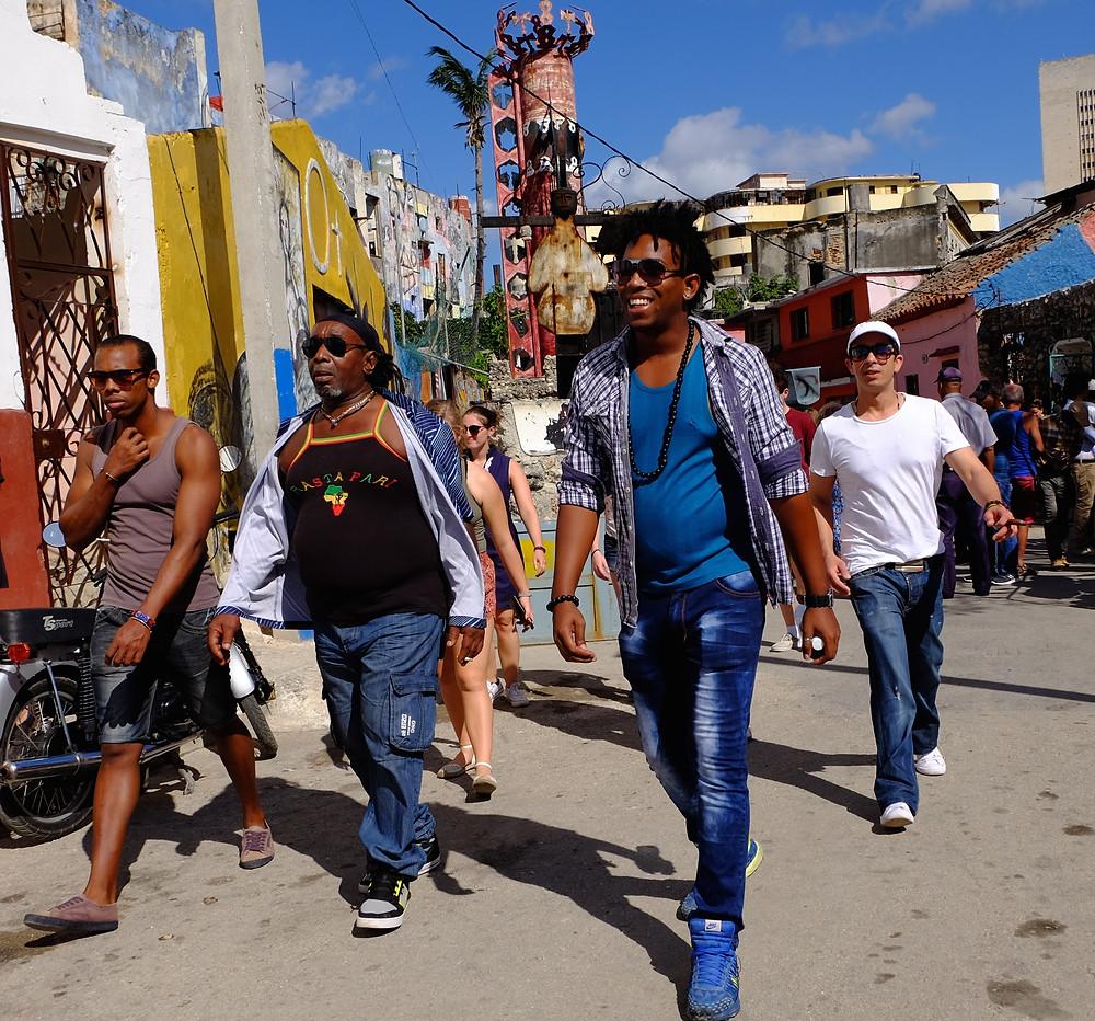 Friends stroll through Callejon de Hamel in Havana Cuba (Jan. 2017)