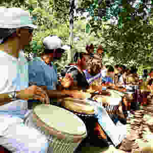 Men participate in a drum circle in Washington, DC.