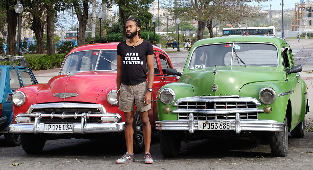 Posing in front of two class American cars in front of the Museum of the Revolution in Havana, Cuba - 1/23/2016