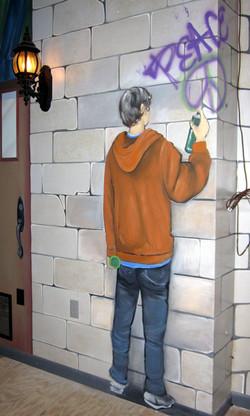 Painting of a teen spraying graffiti