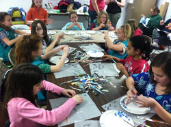 Girl Scouts making paper beads