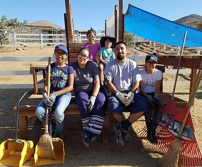 Family Volunteers Together at Saving Grace Animal Sanctuary