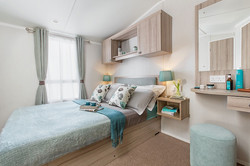 Main Bedroom  - luxury soft furnishings and uphostery - double bed  with lift-up storage - TV point