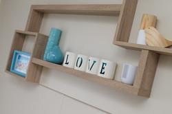 main bedroom - floating shelves design - storage and display  options