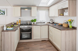 Kitchen - Velux with integral blind - shaker-style design - gas  cooker with recirculating hood - in