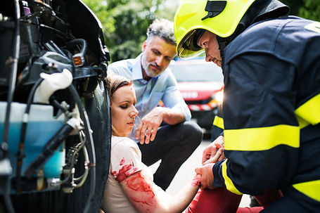 a-firefighter-helping-a-young-injured-wo
