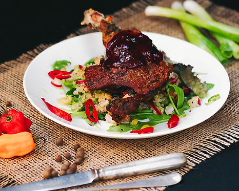 Gluten-Free Duck Confit served with caramberry sauce and quinoa salad