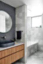glass mosaic, contrast textures, bespoke joinery, modern bathtub