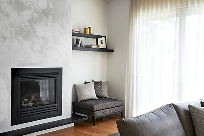 Fireplace wall with shelving