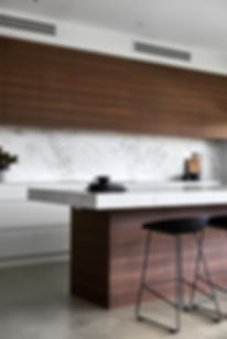 Marble benches, timber cabinets, minimalist stying