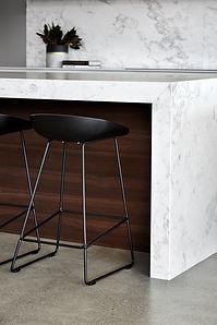 Marble island, timber finishes, kitchen stools