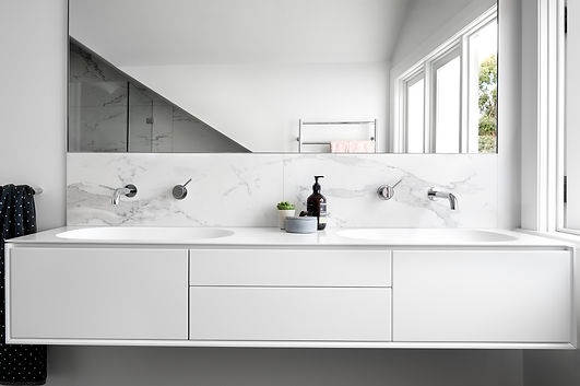 The wall hung vanity features double integrated sinks