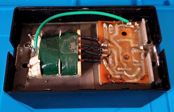 Epoxy potting inside a Commodore 64 power supply