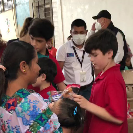 Passing out gifts to children in Guatemala