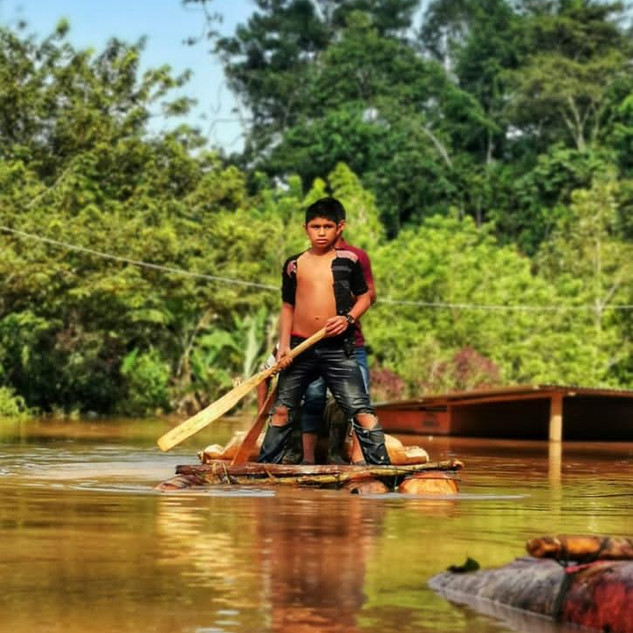 Boys in flood with raft.JPG