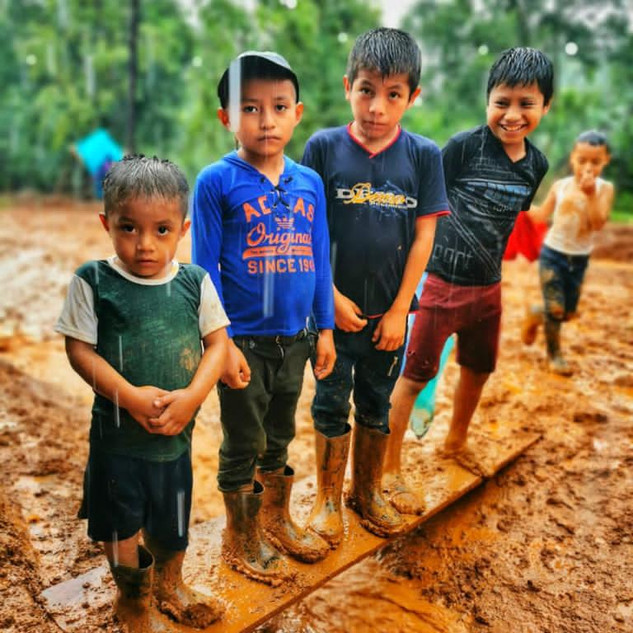 Five children on mud.JPG