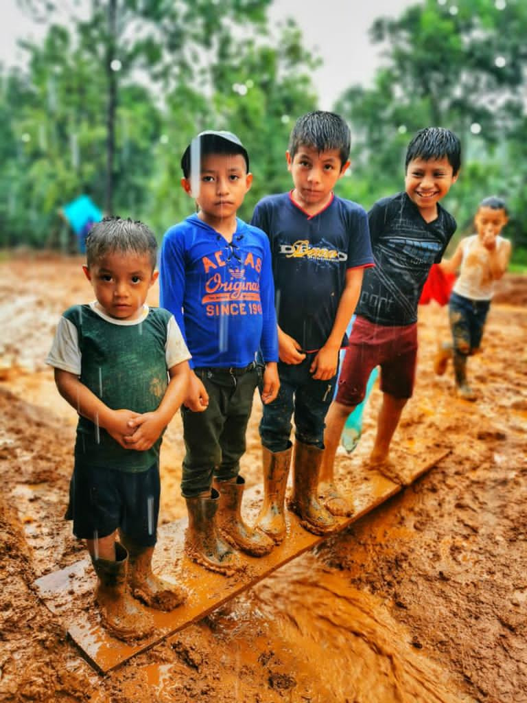 Five children on mud.JPG