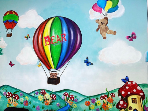 Balloon painting with bear necessities logo