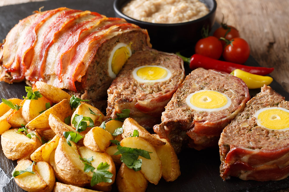 Freshly cooked meat loaf with egg wrappe
