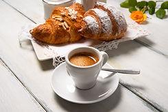 Cup of italian espresso and brioches.jpg