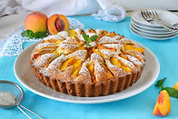 Delicate cake with peaches, dusted with icing sugar .jpg