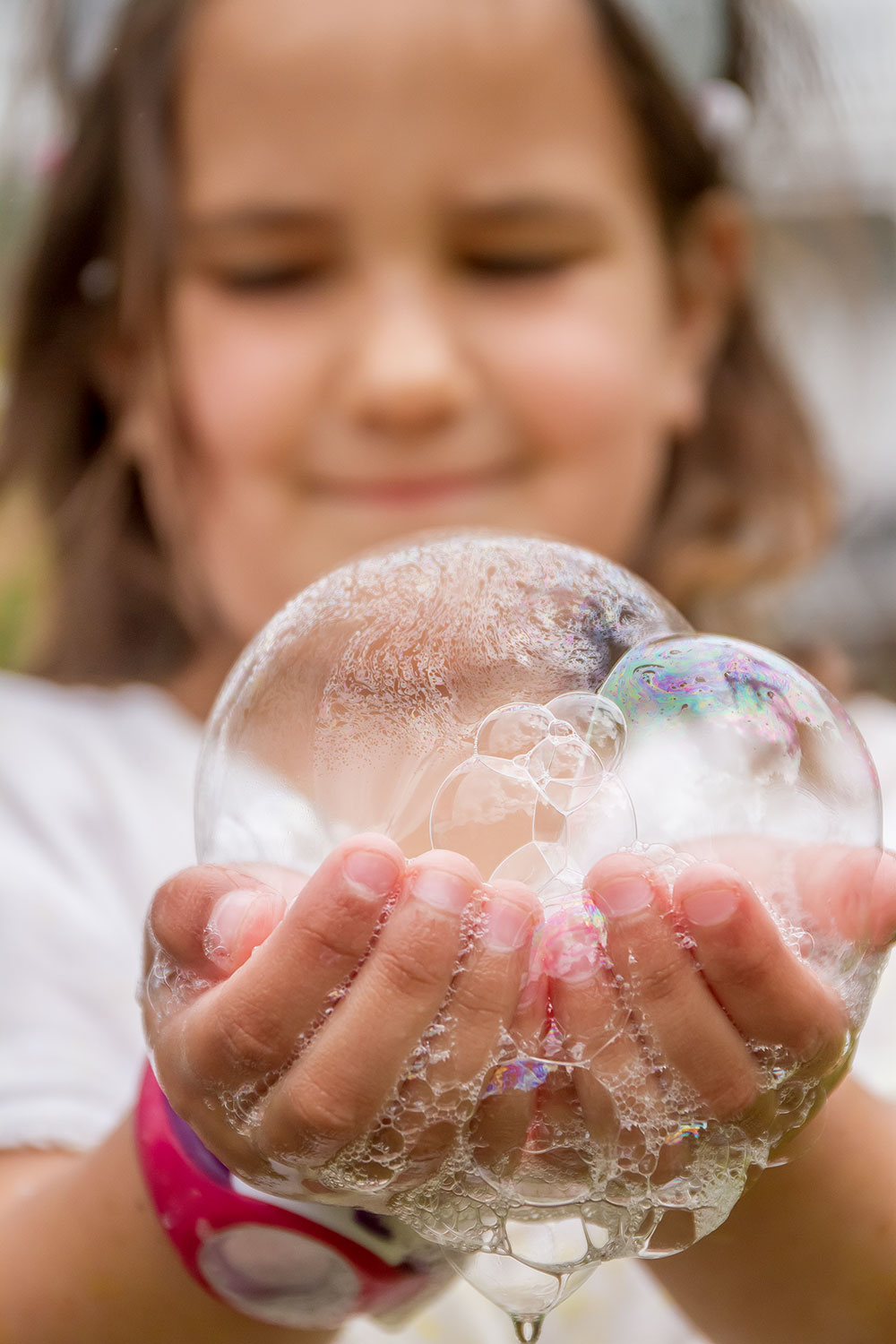 portrait of child girl with bubble