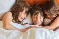 family portrait of 3 kids