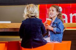 portrait of 2 kids in a cafe