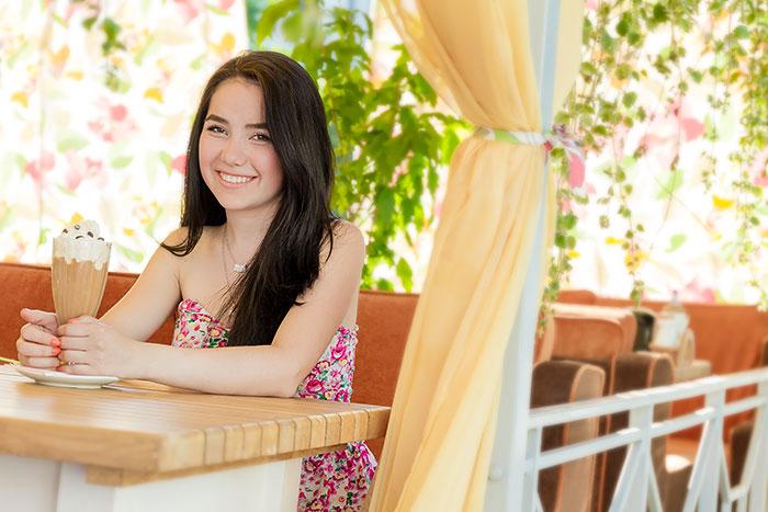 outdoor portrait of girl in cafe