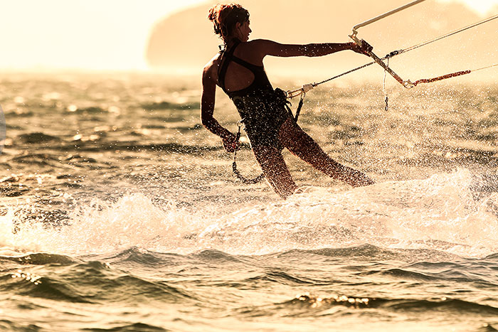 portrait of young kitesurfing lady