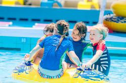 portrait of happy kids in the pool