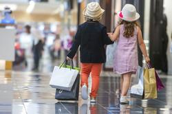 portrait of 2 kids shopping