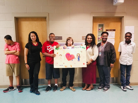 School-Based Clinic Staff presented with poster by Exceptional Needs Students at Terry High School