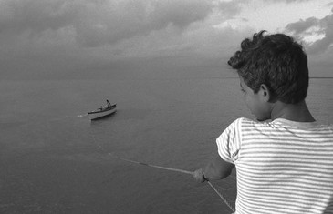 Boy and boat with turtles