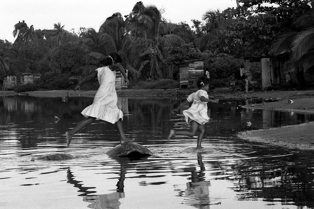 Boy and girl jumping on turtle shield