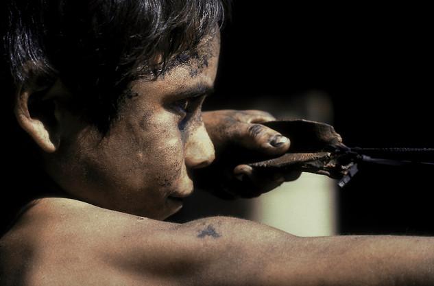 Boy shooting for iguanas