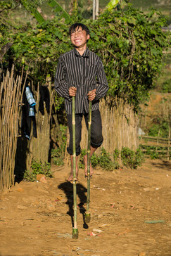 Boy on stilts