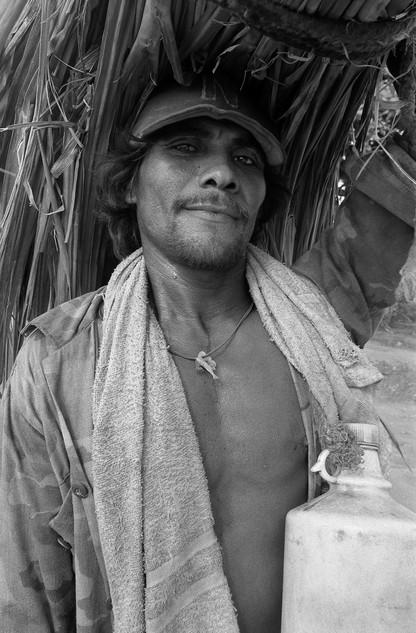 Peasant with sugar canes